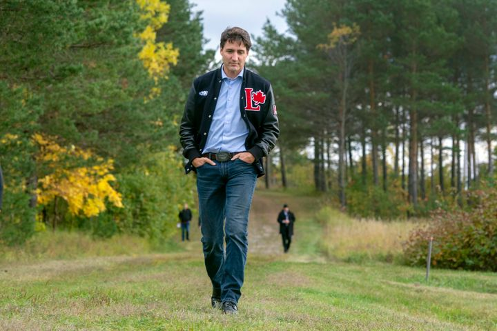 Prime Minister Justin Trudeau arrives to meet the press while campaigning in Mont Joli, Que., on Oct. 4, 2019.