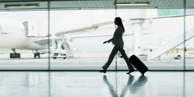 Businesswoman with suitcase in