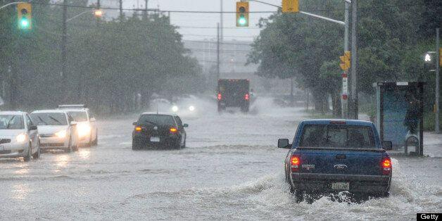 TORONTO, ON - JULY 8: TORONTO, ON - Flooding along the East Mall near Dundas Street West, Monday JULY...