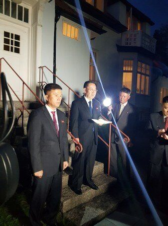 North Korea's chief nuclear negotiator Kim Myong Gil is seen outside the North Korean embassy in