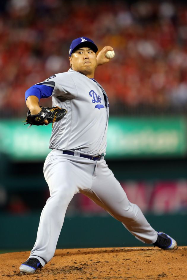 WASHINGTON, DC - OCTOBER 06: Hyun-Jin Ryu #99 of the Los Angeles Dodgers pitches in the first inning...