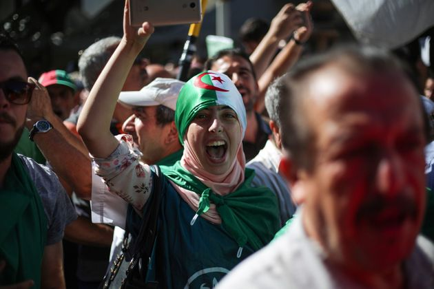 ALGIERS, ALGERIA - OCTOBER 04: Algerians stage a demonstration demanding regime officials -- who continue...