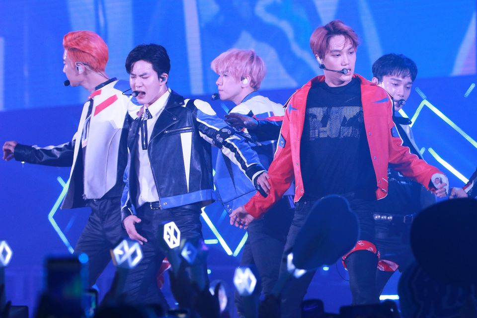 Members of South Korean boy band EXO perform on the stage in concert at AsiaWorld-Expo on August 10,...