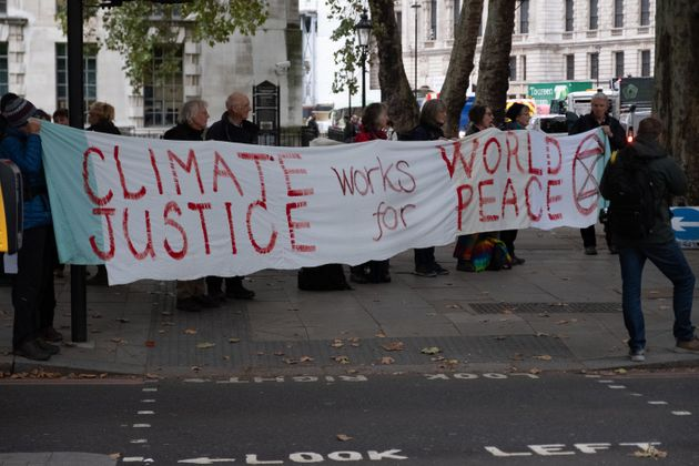 Extinction Rebellion Protesters with Climate Justice banner on the Embankment in London, England on October...