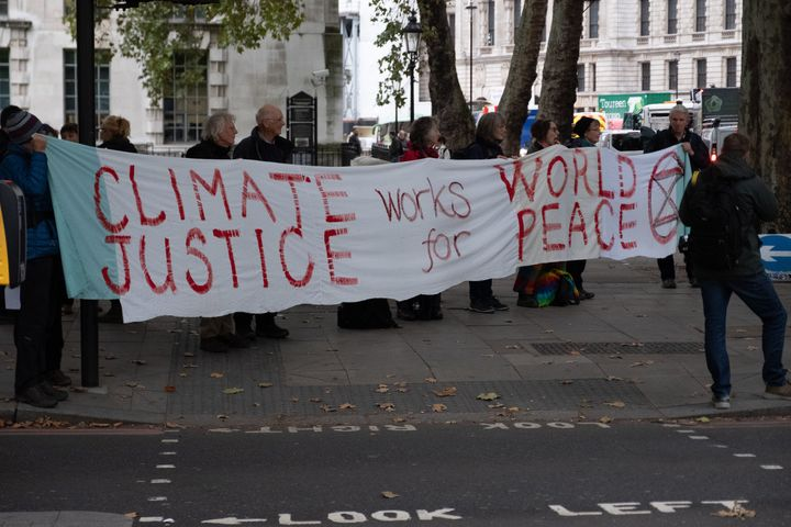 Extinction Rebellion Protesters with Climate Justice banner on the Embankment in London, England on October 7, 2019.(Photo by Robin Pope/ SIPA USA)