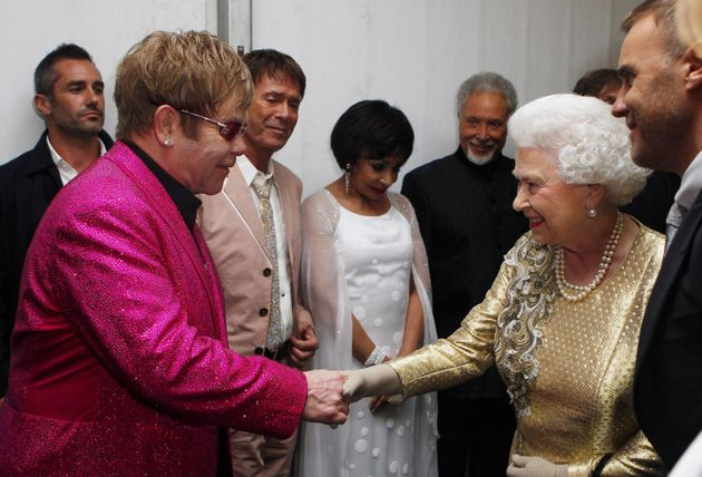 Queen Elizabeth II speaking with Sir Elton John backstage after the Diamond Jubilee concert at Buckingham...