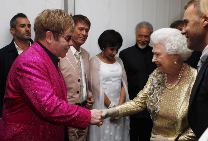Queen Elizabeth II speaking with Sir Elton John backstage after the Diamond Jubilee concert at Buckingham Palace on June 4, 2
