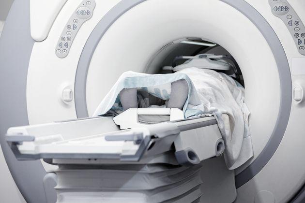 Someone in MRI scan machine. Toned