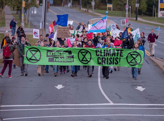 Protesters from the Extinction Rebellion group march towards theAngus L. Macdonald Bridge in Dartmouth,...