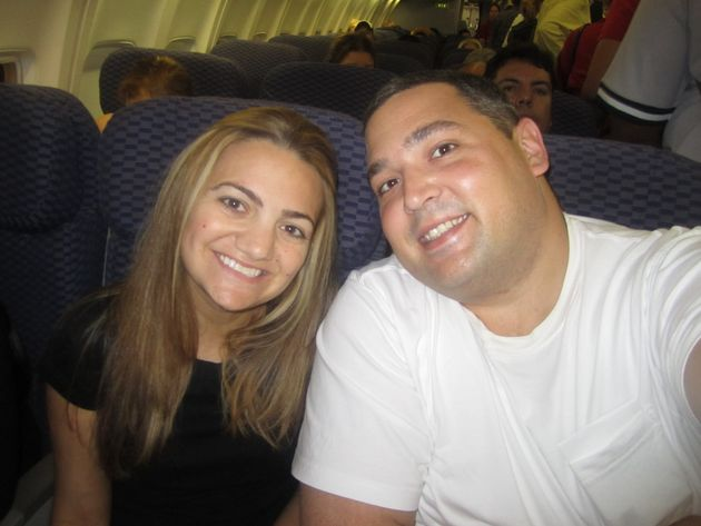 Kimberly Rex and her husband, Anthony, on the plane to meet their older