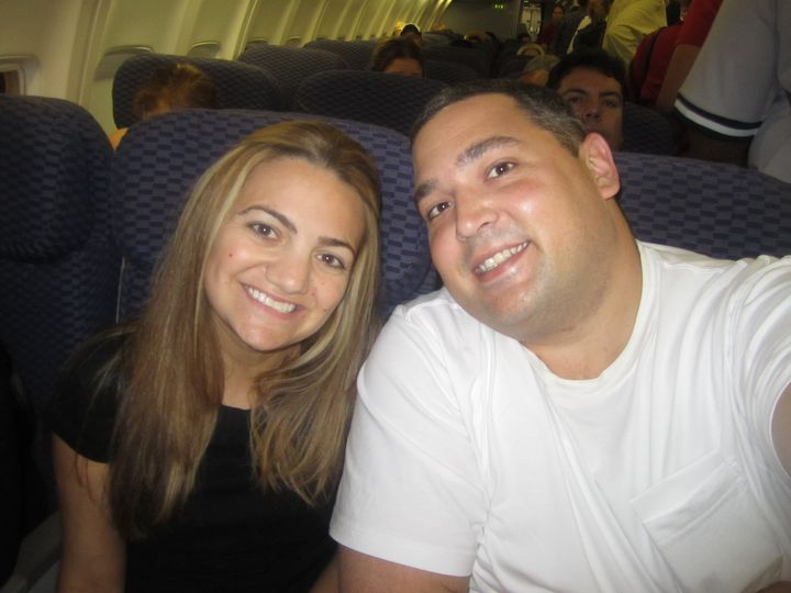 Kimberly Rex and her husband, Anthony, on the plane to meet their older daughter.