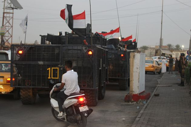 Iraqi police are seen deployed in Baghdad's predominantly Shiite Sadr City, on October 7, 2019. - Demonstrations...