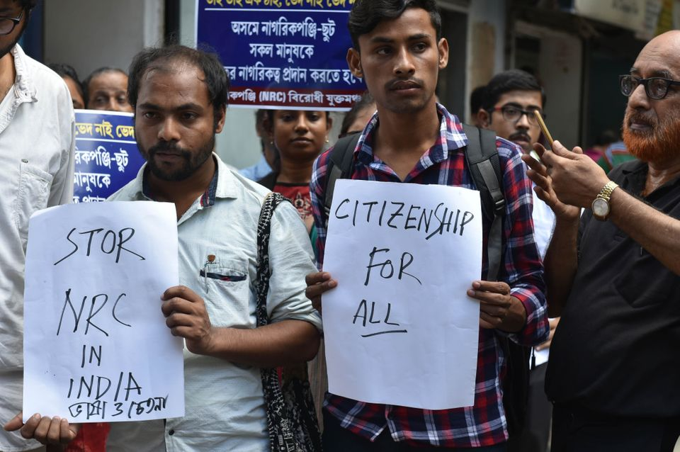 Demonstrators from the Joint Forum Against NRC during a sit in protest against the National Register...