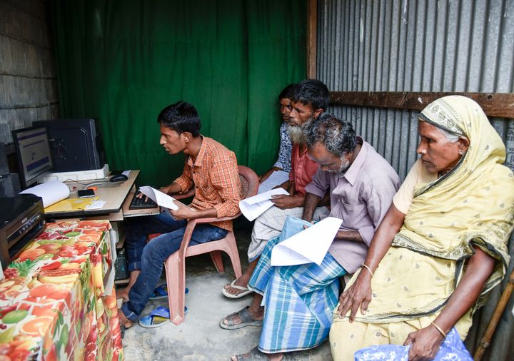 People checks their names in a roadside DTP centre, in the published final list of National Register of Citizens (NRC), in Morigaon district of Assam, India on 31 August 2019.