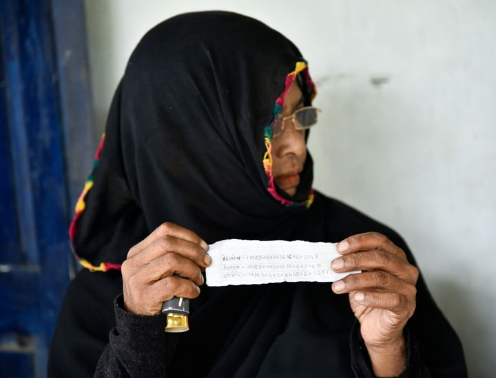 A Muslim woman shows ARN numbers written in a paper slip of her family members as she waiting to check their names in the published final list of the NRC in Morigaon district of Assam, India on 31 August 2019.