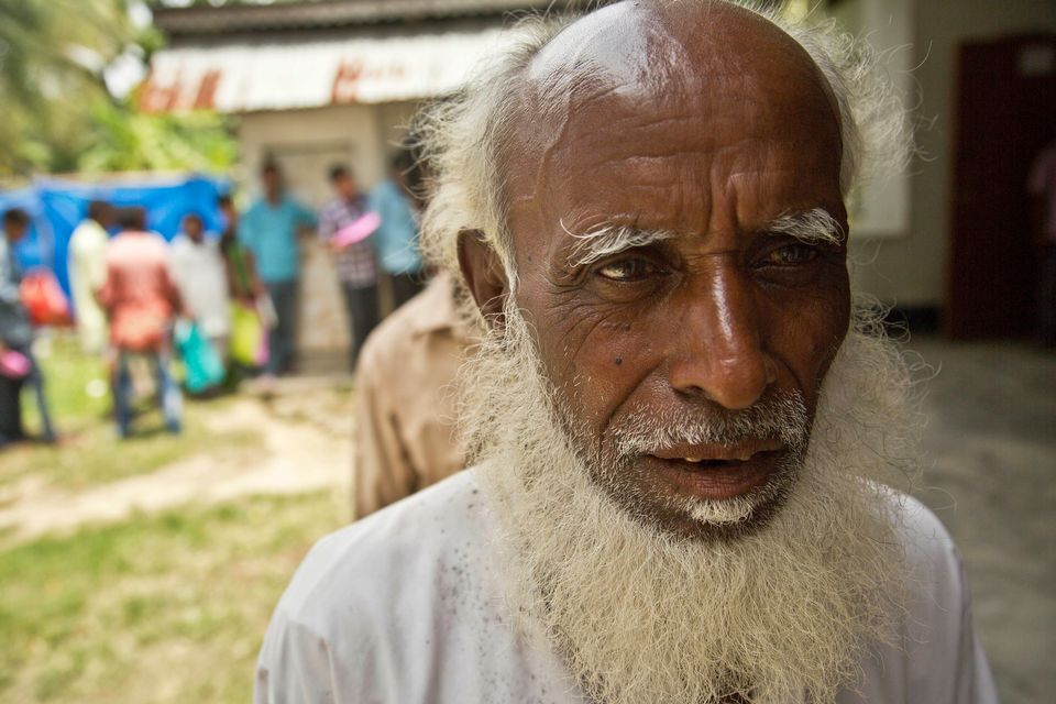 An elderly man, whose name did not appear in the National Register of Citizens (NRC) draft, stands in...
