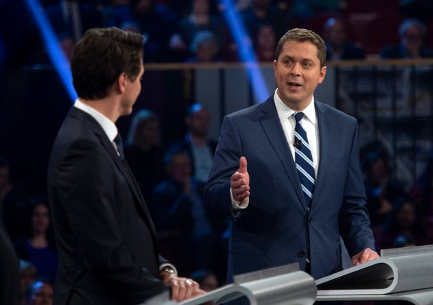 Andrew Scheer gestures towards Justin Trudeau as he speaks during the federal leaders' debate in Gatineau,...