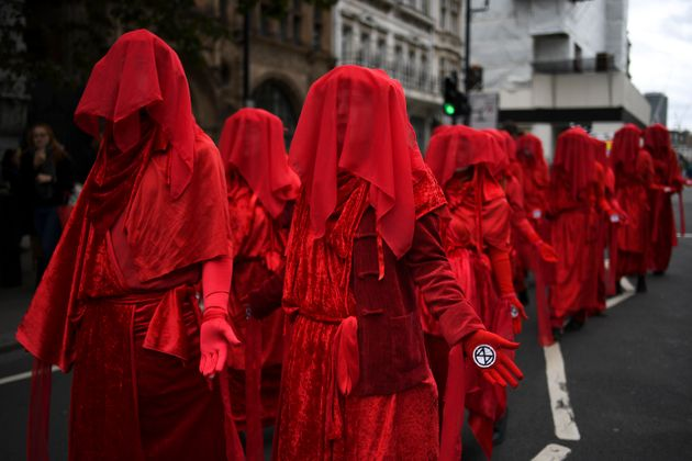 Climate activists take part in a demonstration at Whitehall, in London, Monday, Oct. 7,