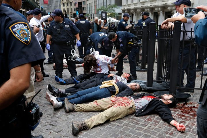 New York City Police arrest activists with the Extinction Rebellion movement as they demonstrate outside the New York Stock E