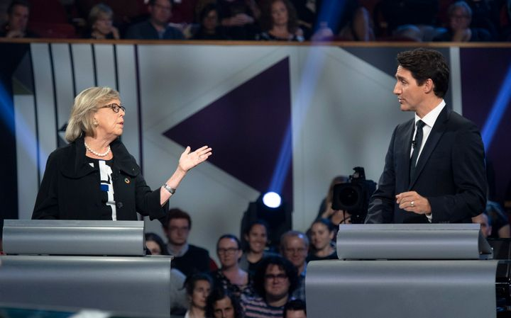 Green Party Leader Elizabeth May and Liberal Leader Justin Trudeau gesture to each other as they both respond during the federal leaders' debate in Gatineau, Que. on Oct. 7, 2019.