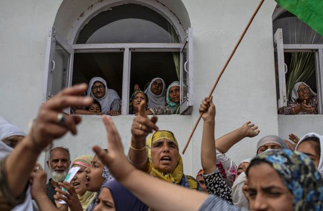 Kashmiri women shout slogans in Anchar neighbourhood after Friday prayers during restrictions in Srinagar...