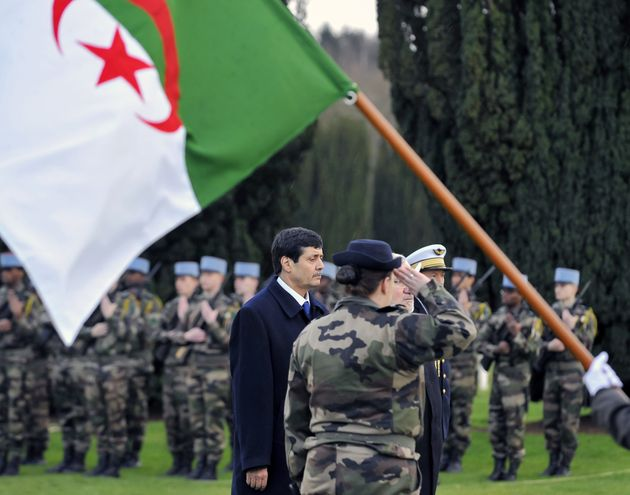 Algerian Minister for Veterans Tayeb Zitouni (L), flanked by French Junior Minister for Veterans and...
