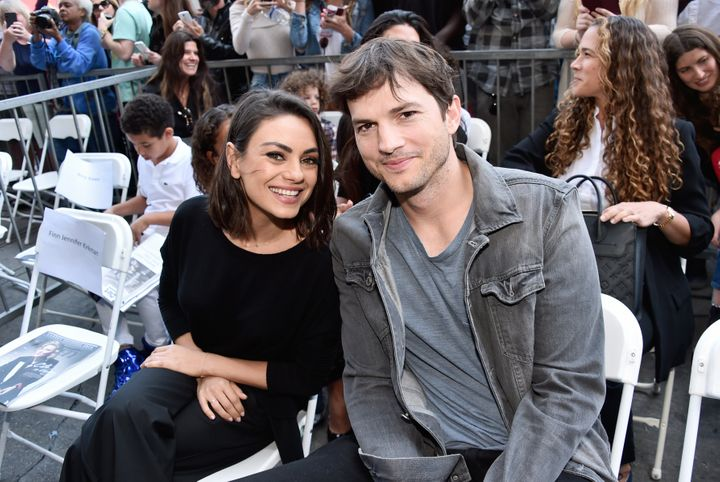 Mila Kunis and Ashton Kutcher attend Zoe Saldana's Walk of Fame star ceremony in May 2018.
