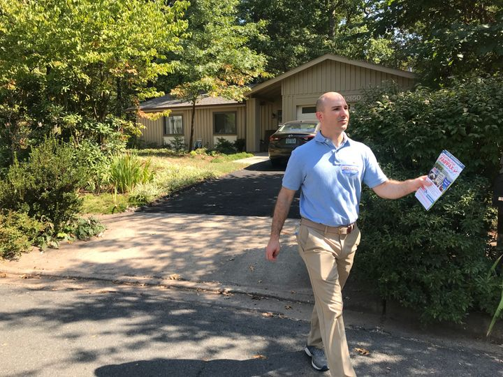Steve Descano, the Democratic candidate for Fairfax County prosecutor, knocks on doors last month.