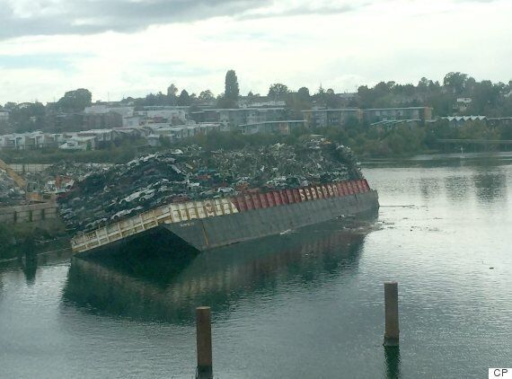 Victoria Harbour Barge Tips As Many As 20 Vehicles Into