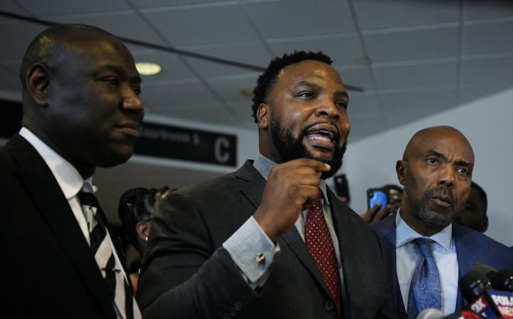 Botham Jean's family attorneys, Benjamin Crump, Lee Merrit and Daryl Washington, address the press after the conviction