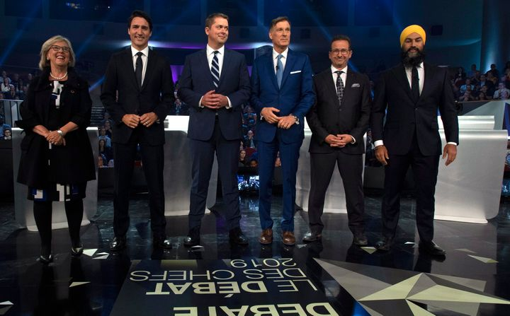 From left to right: Green Party Leader Elizabeth May, Liberal Leader Justin Trudeau, Conservative Leader Andrew Scheer, People's Party Leader Maxime Bernier, Bloc Québécois Leader Yves-François Blanchet, and NDP Leader Jagmeet Singh pose for a photo before a federal leaders' debate earlier this month.