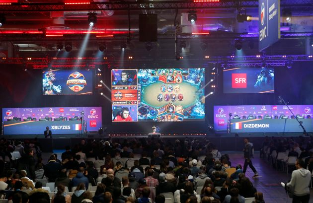 Fans watch a Hearthstone video game tournament during Paris Games Week last October in
