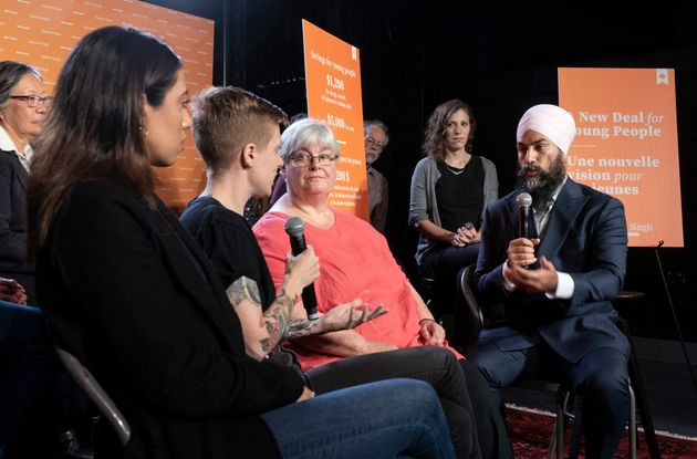 NDP Leader Jagmeet Singh talks with people on a panel in Toronto, on Oct. 8,