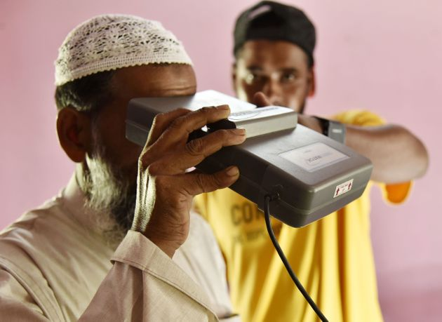 A man takes an iris scan to link his Aadhar card with the National Register of Citizens (NRC) in Assam'sBarpeta...