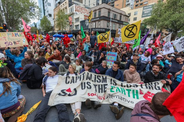 Demonstrators stage a sit-in on a road during an Extinction Rebellion protest in Melbourne on