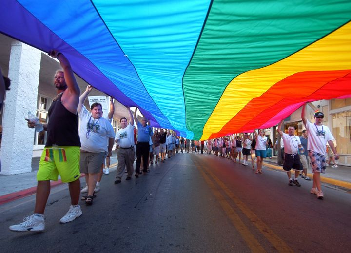 Participants walk with a 100-foot rainbow flag during the Hillsborough Pride in Exile weekend celebration Aug. 13, 2005, in K