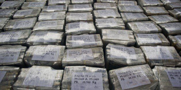 Dozens of 25kg-packages of drug totalizing more than 7 tons of cocaine are presented at the police airport...