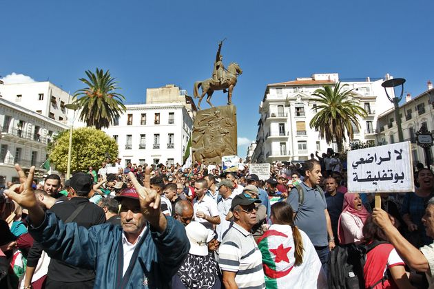 Algerian demonstrators gesture during an anti-government protest in the capital Algiers on October 8,...