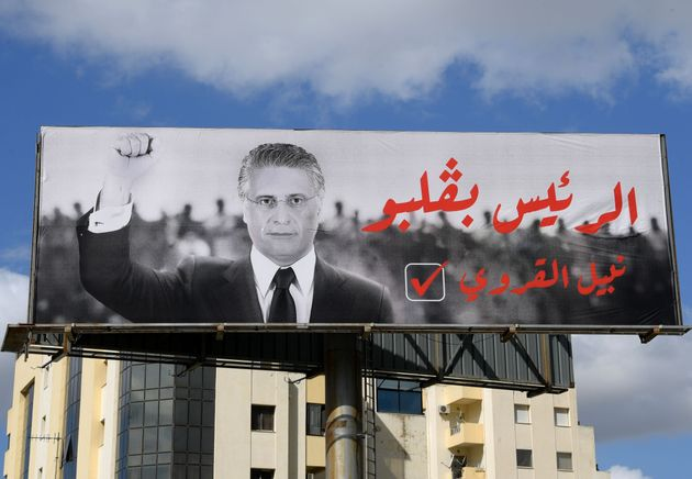 An electoral poster of Tunisian presidential candidate Nabil Karoui is pictured along a road in the capital...