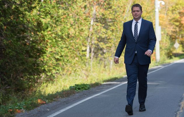Conservative Leader Andrew Scheer walks down Roxham Road in Quebec near the Canada-U.S. border to make...