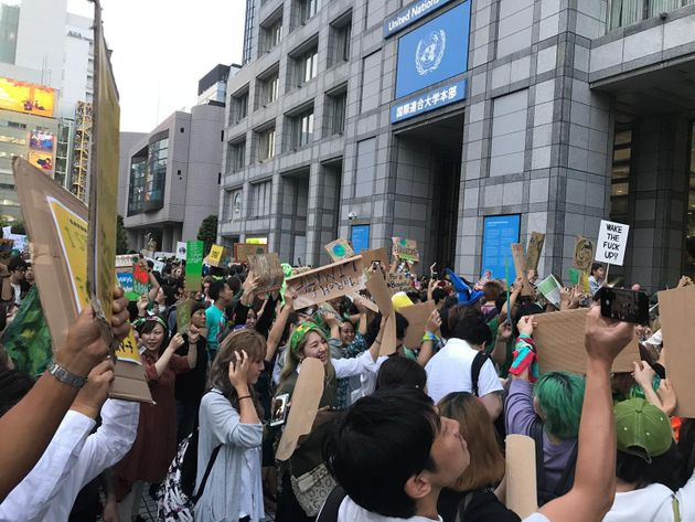 Activists protesting outside of the United Nations University in Tokyo on Sept.