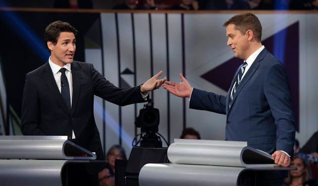 Conservative leader Andrew Scheer (right) and Prime Minister and Liberal leader Justin Trudeau gesture...