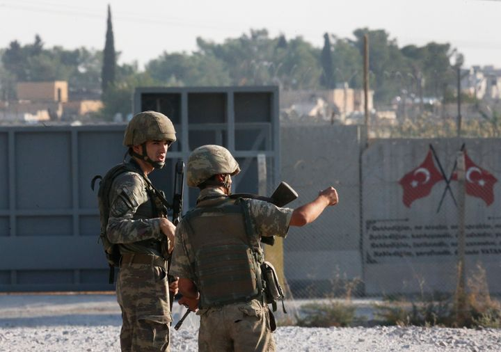 Shortly after the Turkish operation inside Syria had started, Turkish soldier stand at the border with Syria in Akcakale, San