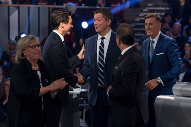 Liberal leader Justin Trudeau shakes hands with Conservative leader Andrew Scheer following the federal leaders' debate at the Canadian Museum of History in Gatineau, Que. on Oct. 7, 2019.
