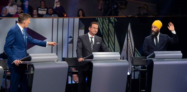 Bloc Quebecois leader Yves-Francois Blanchet listens to Jagmeet Singh during the federal leaders' debate...