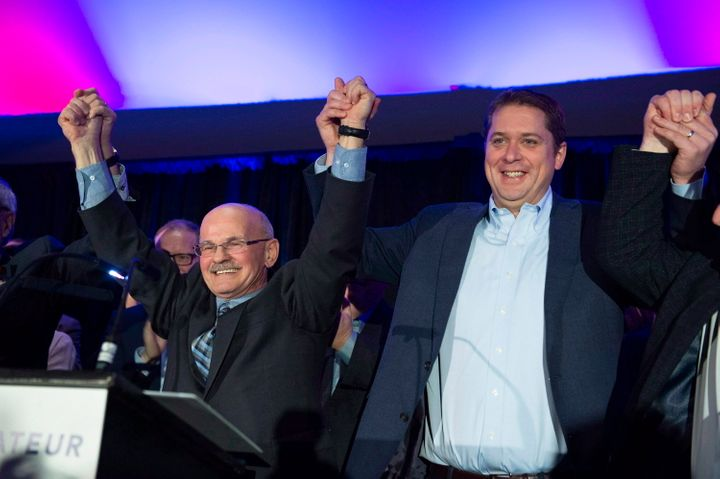 Conservative Leader Andrew Scheer, right, raises the arms with Richard Lehoux, left, candidate in the Beauce riding on Nov. 3, 2018 in St-Elzear Que.