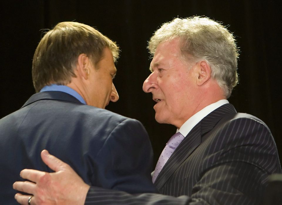 Maxime Bernier speaks with his father Gilles Bernier in St-Georges, south of Quebec City on June 25, 2008.