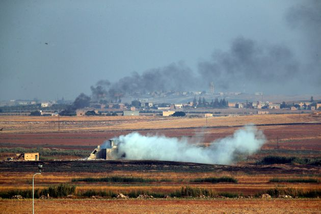 Smoke billows from targets inside Syria during bombardment by Turkish