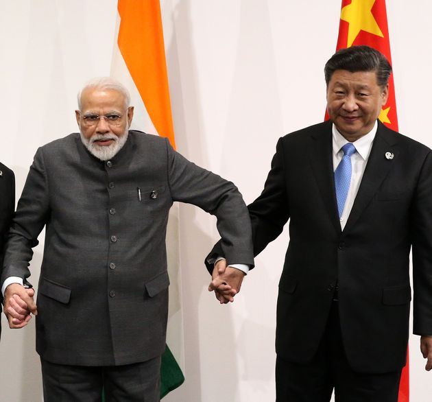 Prime Minister Narendra Modi and Chinese President Xi Jinping pose for a group photo prior to their trilateral...