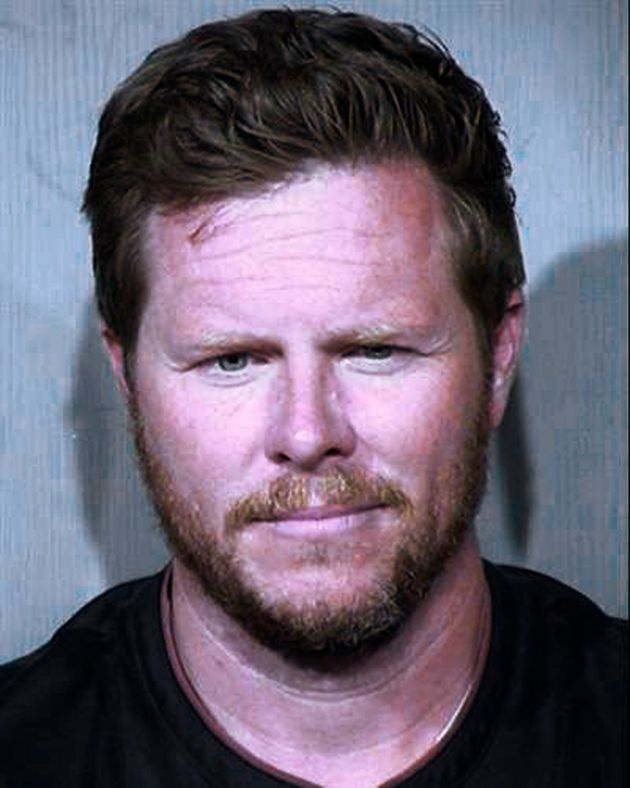 This undated booking photo provided by the Maricopa County Sheriff's Office shows County Assessor Paul...